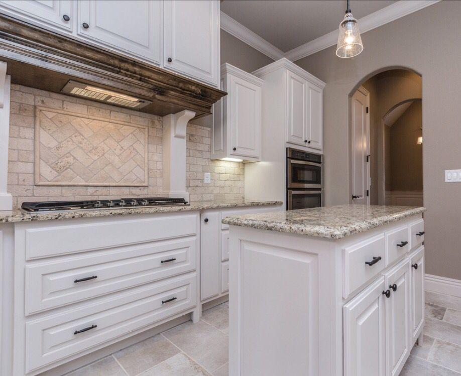 Spacious White Kitchen With Light Travertine Backsplash Including Herringbone Patterned Ins