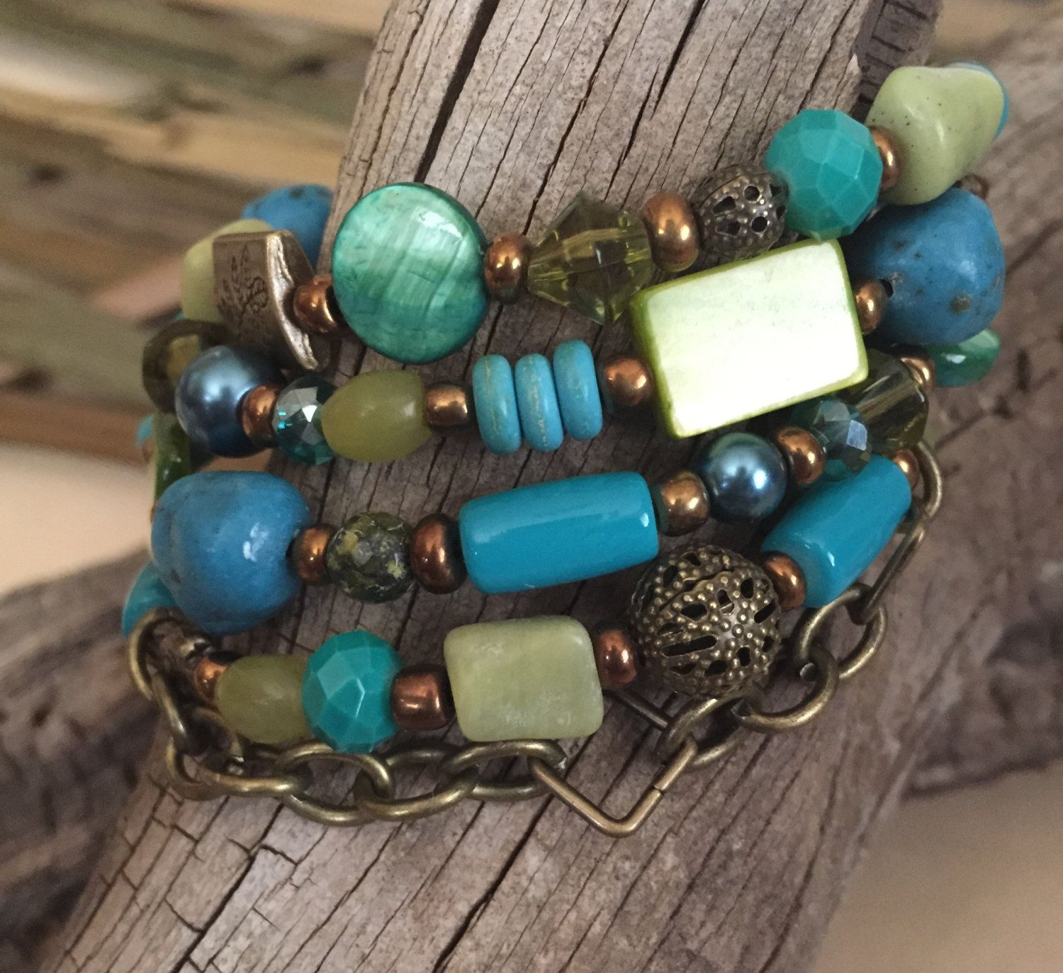 Turquoise, Blue, Teal, Green and Bronze Chain Beaded Coil Bracelet by PeacocksandLeopards on Etsy $27