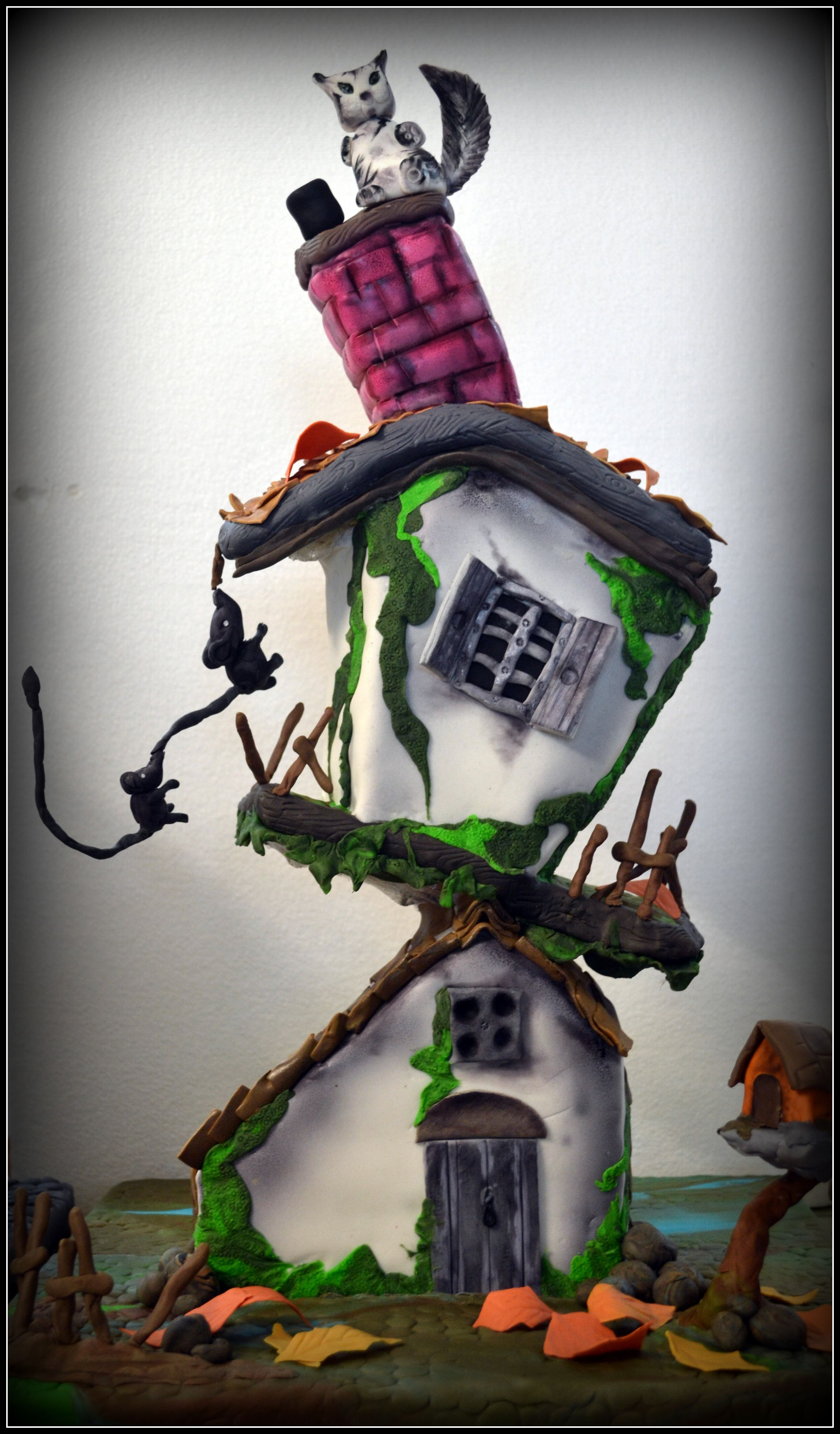 whimsical cake crafted by students at 32 degree - cakes set at steep angles