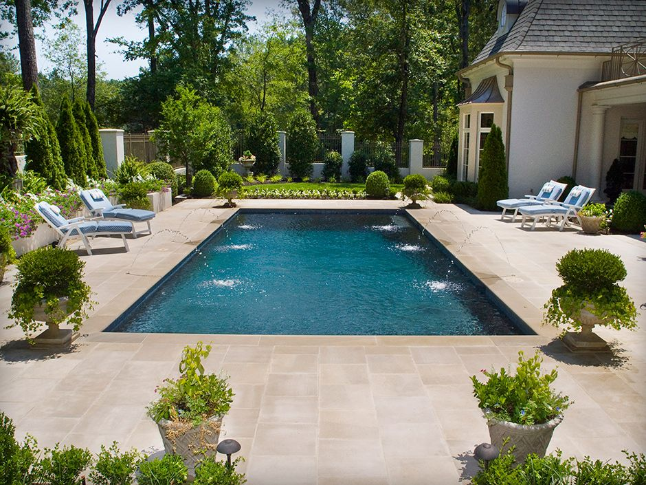 Traditional rectangular swimming pool with deck jets for Pool and backyard design