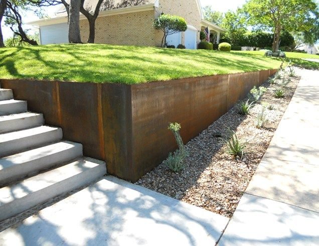 steel retaining wall retaining and landscape wall austin outdoor design austin - Landscape Design Retaining Wall Ideas
