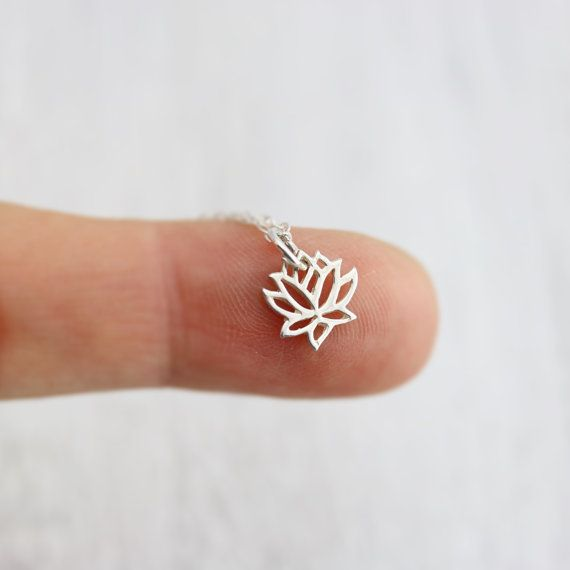 Sterling Silver Tiny Lotus Necklace. This delicate and detailed openwork tiny lotus flower pendant is a perfect everyday necklace. Its full, unfolding petals suggest the expansion of the soul. The lotus has spiritual symbolism amongst many cultures, but its beauty and grace is undeniable!  » Sterling Silver Tiny Lotus Pendant (10mm x 10mm) » Sterling Silver Cable Chain (select from drop-down on upper right) » Your jewelry purchase will come beautifully packaged for gift giving.  *****PLEASE…