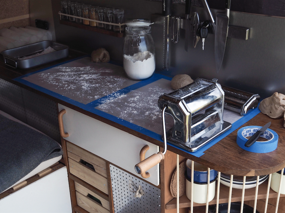 Interior design for a DIY campervan conversion !  With our wide countertop made of solid wood, we're able to prep fresh and delicious pasta to enjoy in the van, whenever our home on wheels takes us !