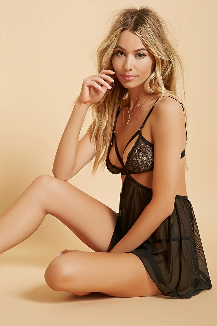 82de982b10 A lingerie set featuring a sheer mesh knit slip with a strappy lace bralette  top