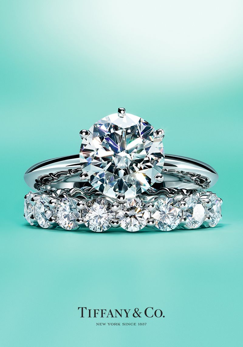 670fb023d89 The Tiffany® Setting engagement ring and Tiffany Embrace® band ring in  platinum.