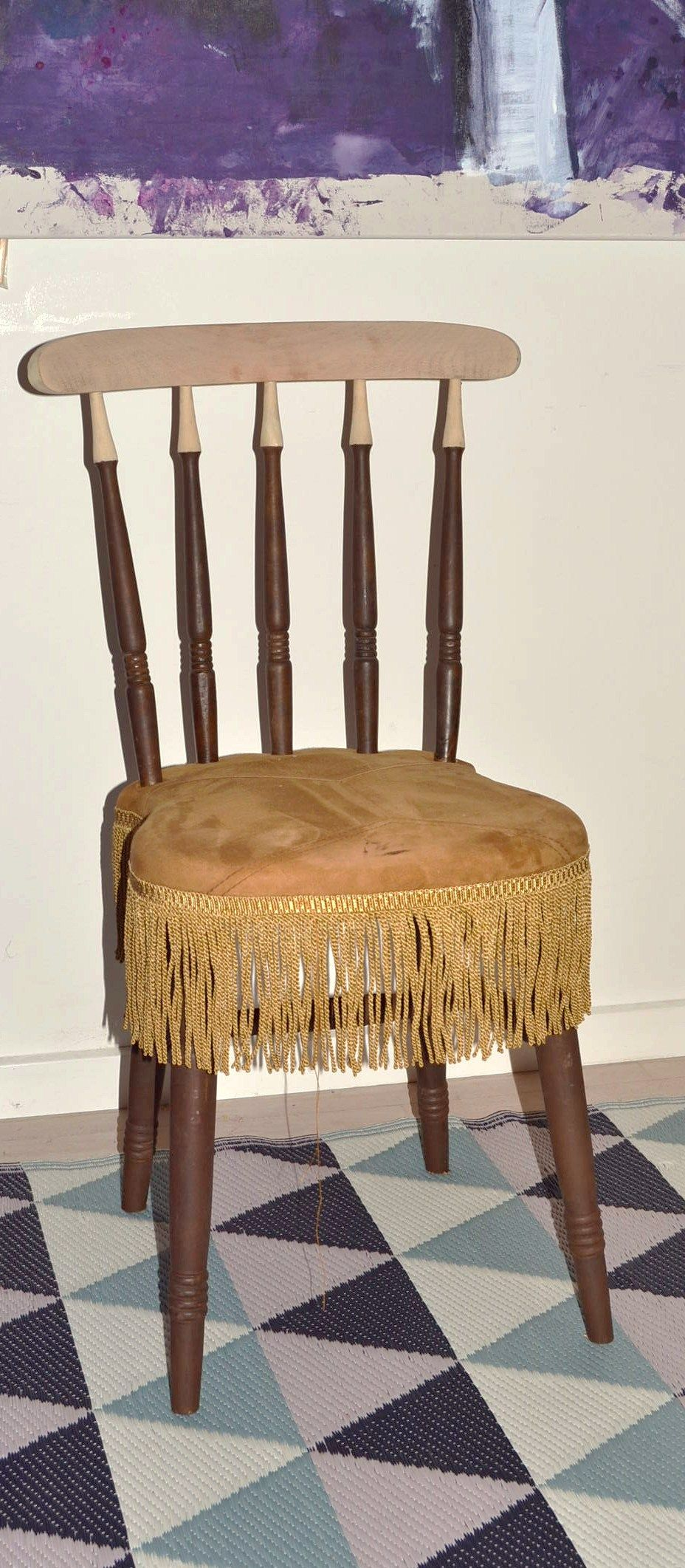 Old chair, sanded at the top an upholstered with the back of a jacket