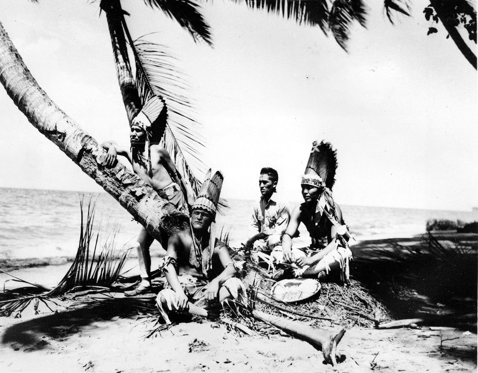 Dec. 1943: American Navajo Indians from Southwest United States, members of the 158th U.S. Infantry, are seen on a beach in the Solomon Islands. They are in their traditional dress for a tribal ceremony at Christmastime. From left to right are, Pfc. Dale Winney, Gallup, N.M; Pvt. Perry Toney, Holbrook, Ariz.; Pfc. Joe Gishi, Holbrook; and Pfc. Joe Taraha, Gallup. (AP Photo/U.S. Army Signal Corps)