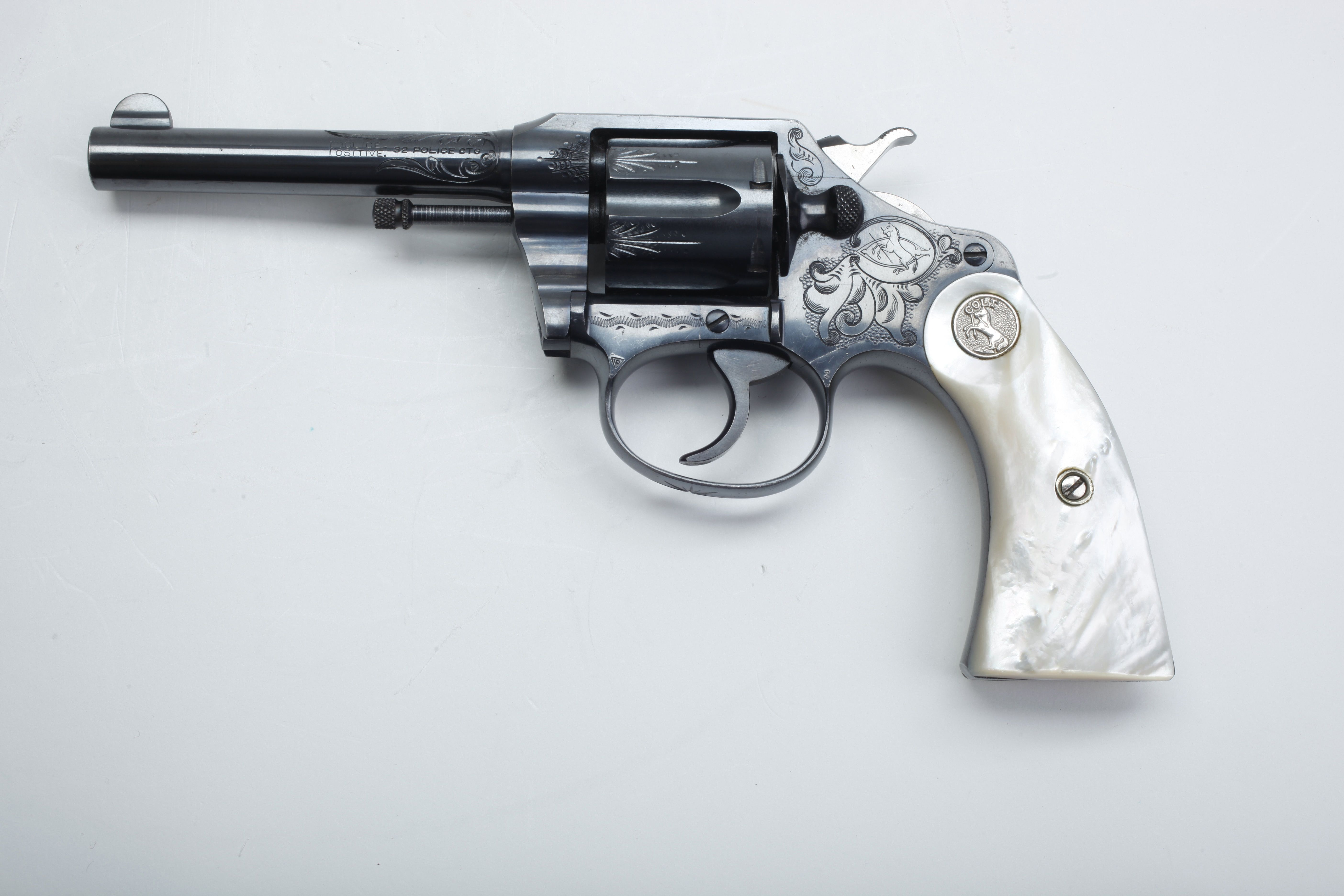 Engraved @Chelsea Rose Rose Rose Rose Satterfield Police Positive - One of the very nicest .32 caliber Colt Police Positive revolvers made; fitted with factory mother-of-pearl grip panels and refined engraving.  Made from 1907 to 1947, this small frame double-action once outfitted many constables and officers around the nation.  Available in fixed sight or target versions, and in blued and nickled finishes,