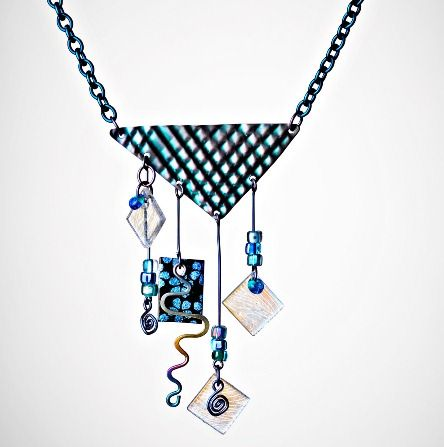 Carnivale! necklace by Marti Brown. Beautiful metal work. http://www.jewelrydesignermagazine.com