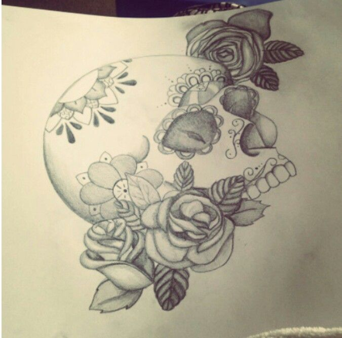 pencil drawing of a skull and roses boog style tattoo