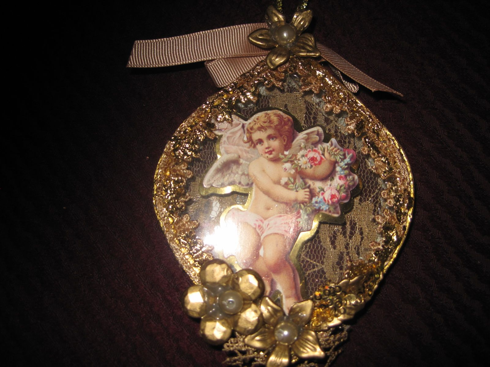 LOVE THESE! absolutely beautiful. glass ornament with cherub inside. Lace and jewels embellish these.
