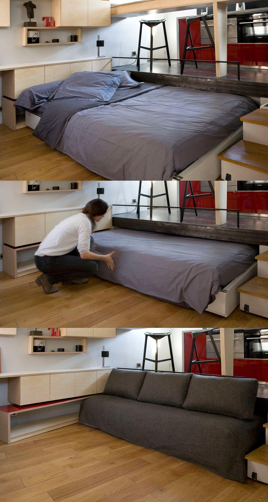 Great space saver! Bed slides under the kitchen floor, creating sofa for daytime use in studio apt. By Julie Nabucet.