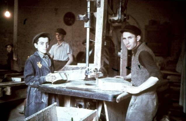 Lodz, Poland, Jewish youth, wearing the Jewish badge, in a carpentry shop in the ghetto..
