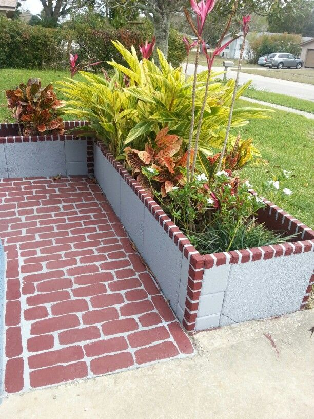 Painted concrete flower box and walkway