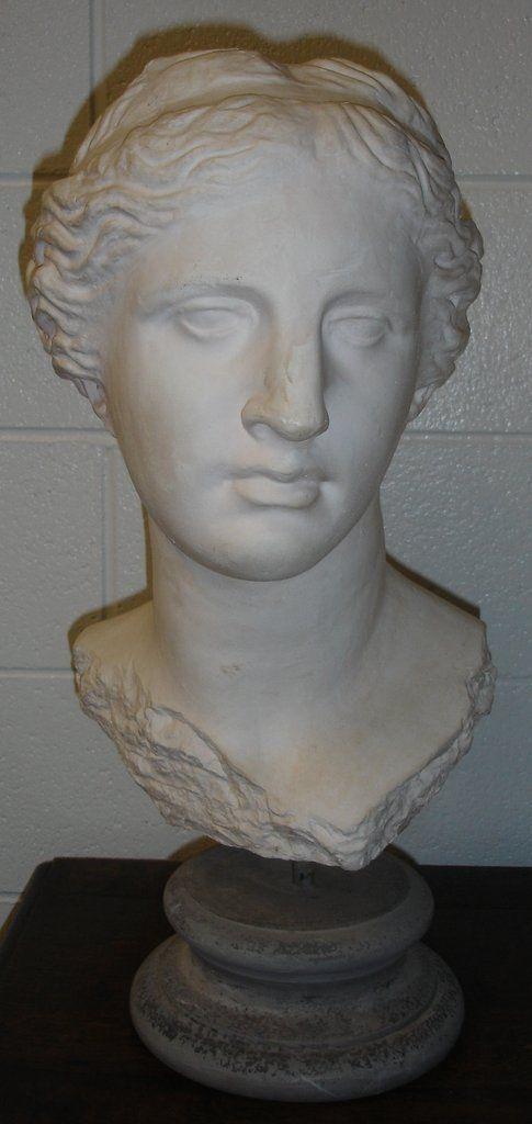 Contemporary sculpture, Womans head on round stone pedestal