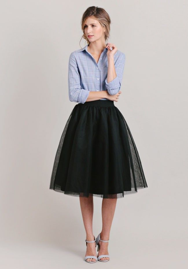 Fall in love with this black midi skirt designed with two ...
