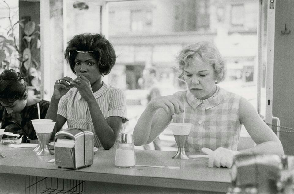 This photo shows an African American woman sitting at a white only counter.  The owners would tell them to move and when they wouldn't the owner of the resterant would call the police and the woman would be dragged out and taken to jail.