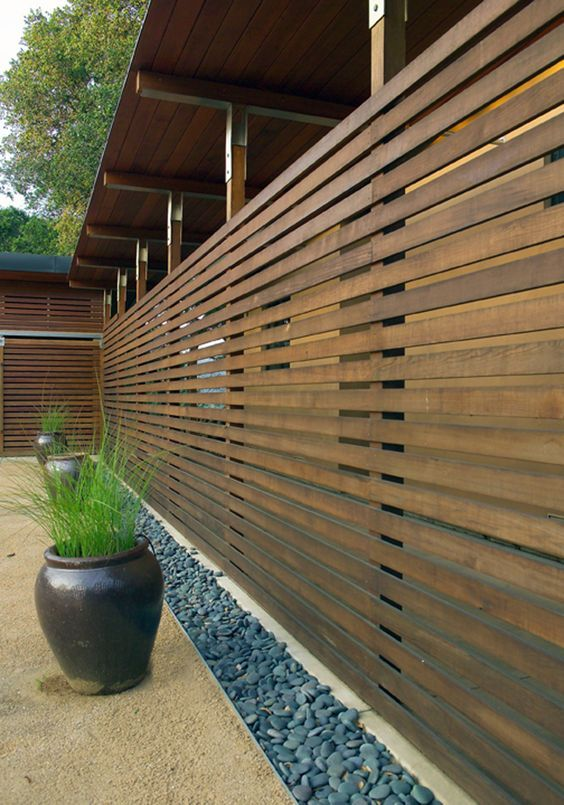 Adding A Perimeter Where The Wall And Floor Meet E G Quartz Stone Or Pebbles Adds Visual Interest An Fence Design Privacy Fence Designs Diy Privacy Fence