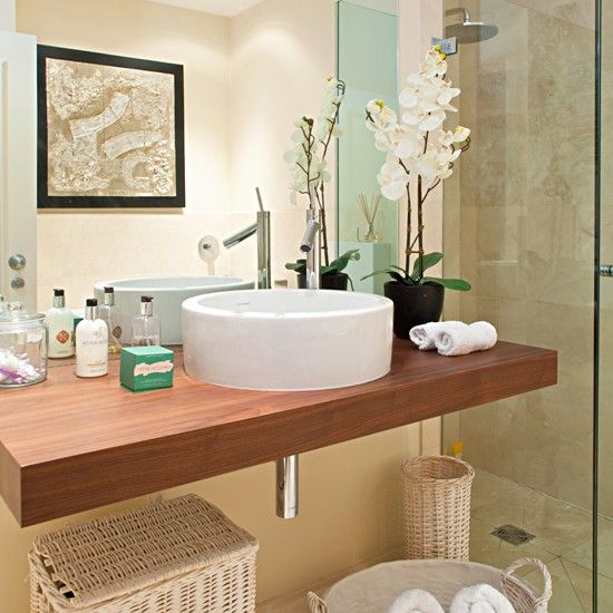 A chic countertop basin unit leaves room for handy storage