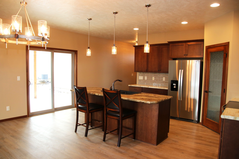 Starmark Cherry Cabinets Tau Maiolica Gloss Tan Tile Backsplash Hand Selected Light Fixtures Formica Lapidus B Kitchen Flooring Luxury Flooring Custom Homes