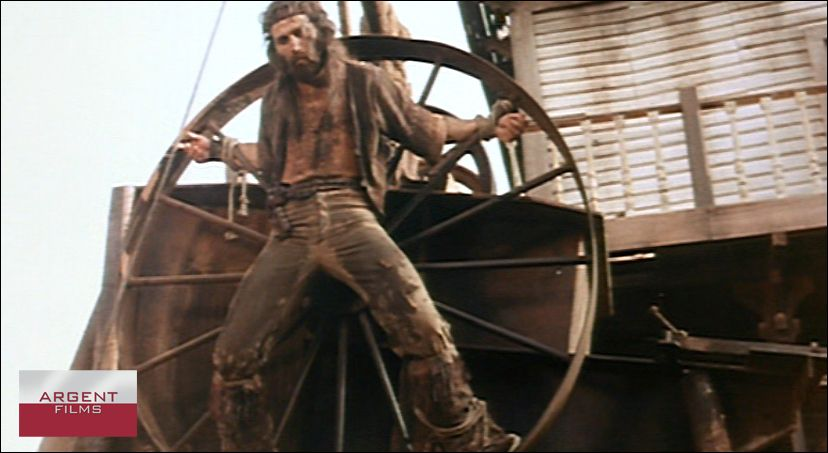Keoma is crucified by his half brothers onto a wagon wheel and paraded before the entire town. KEOMA - starring Franco Nero and directed by Enzo G. Castellari.