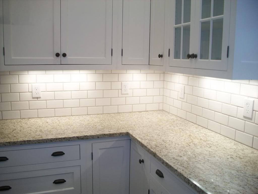 lowes white subway tile that we used in basement br with mobe pearl grout from the tile shop