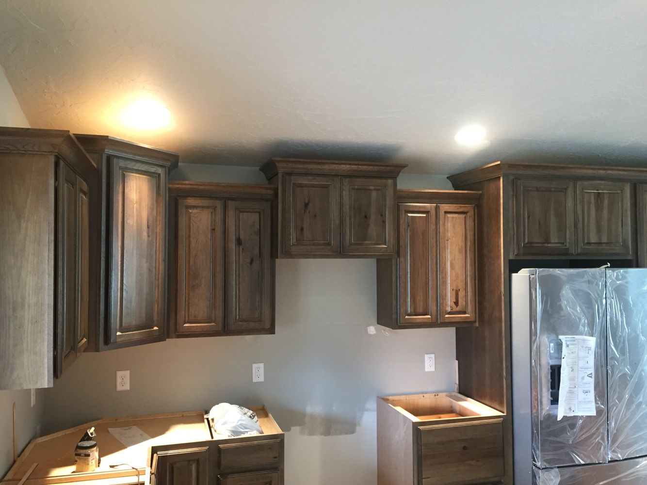 Dark stain hickory cabinets with crown moulding kitchen for Black stained cabinets