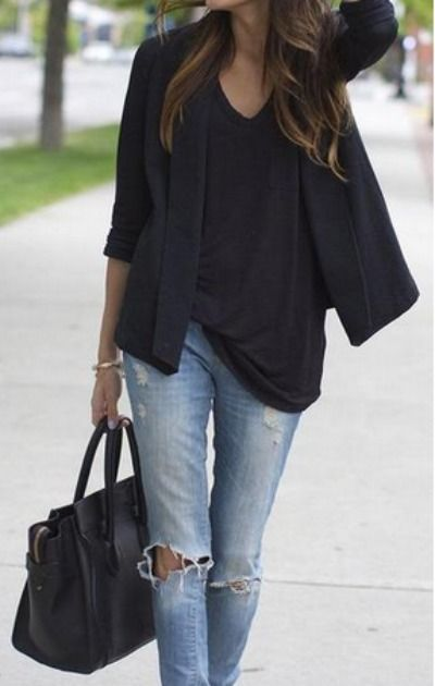 Keep it casual with simple ripped jeans and black accessories.