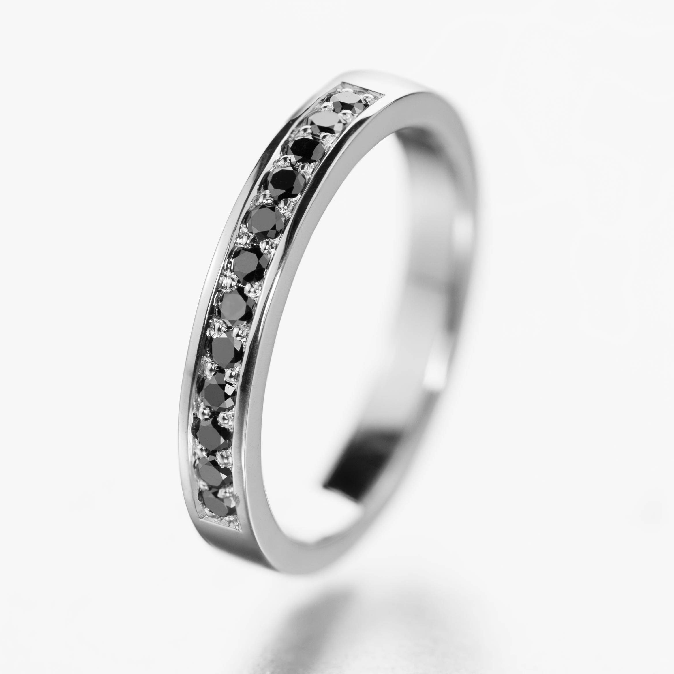 Half eternity ring with black diamonds.