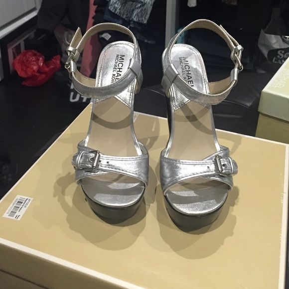 Michael kors silver heels! Super cute and super high 5 inch heels. In good condition. Comes with box. MICHAEL Michael Kors Shoes Heels