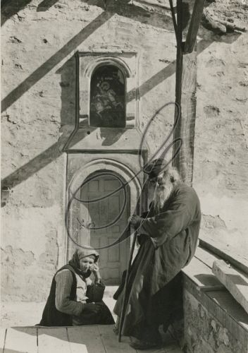 PELOPONNESUS, GREECE.   A Greek monk and his wife sit outside of a convent. Fred Boissonnas.  Credit: National Geographic Stock: Vintage Collection / The Granger Collection, NYC — All rights reserved.