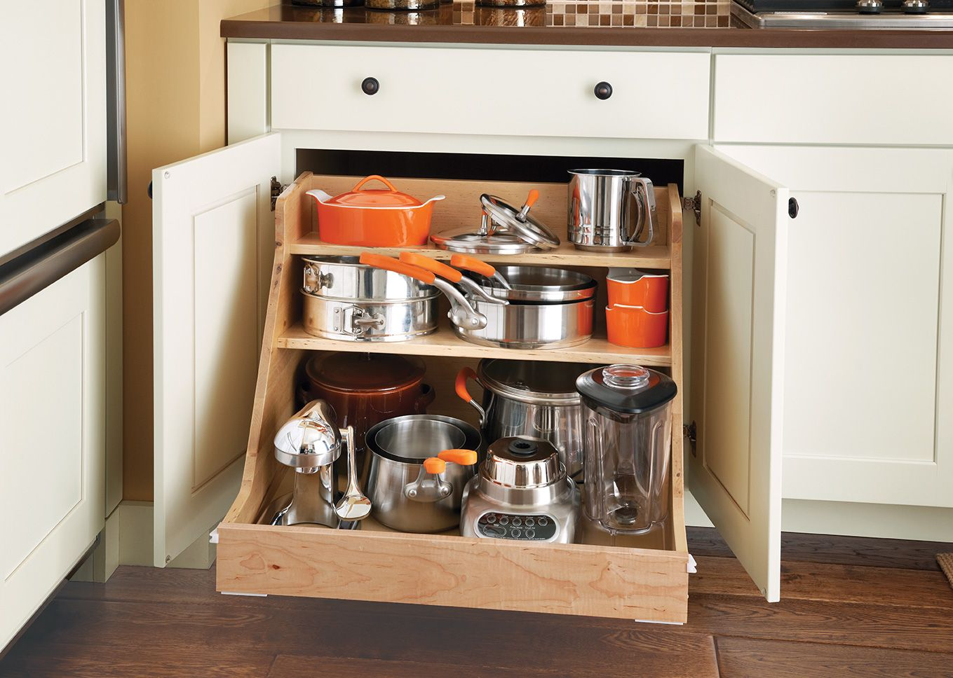 Base Pot And Pan Organizer Forget Clanking Through All Your Cookware Use This Easy Roll Out Organizer Pan Organization Home Depot Cabinets Kitchen Cabinetry