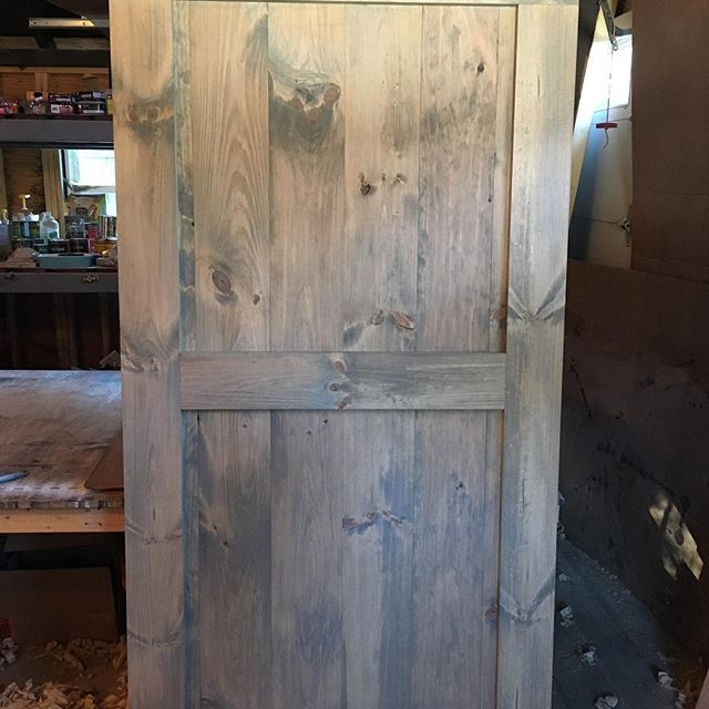 This Mid Bar With Border Barn Door Stained With Minwax Weathered Oak Is Ready For Its New Home We Love The Subtl Barn Door Stained Doors Interior Barn Doors