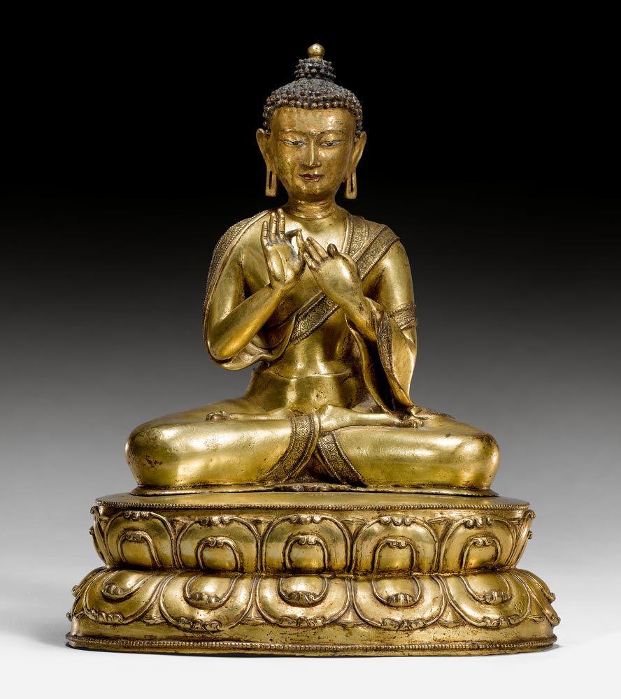 A gilt copper figure of the Buddha Dipankara. Tibet, 15th c.