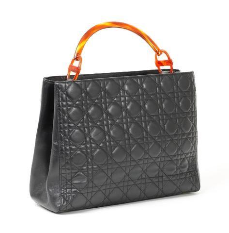 Chistian DIOR, Sac en cuir matelassé noir, double compartiment et poche  zippée à l 4c21b88da50