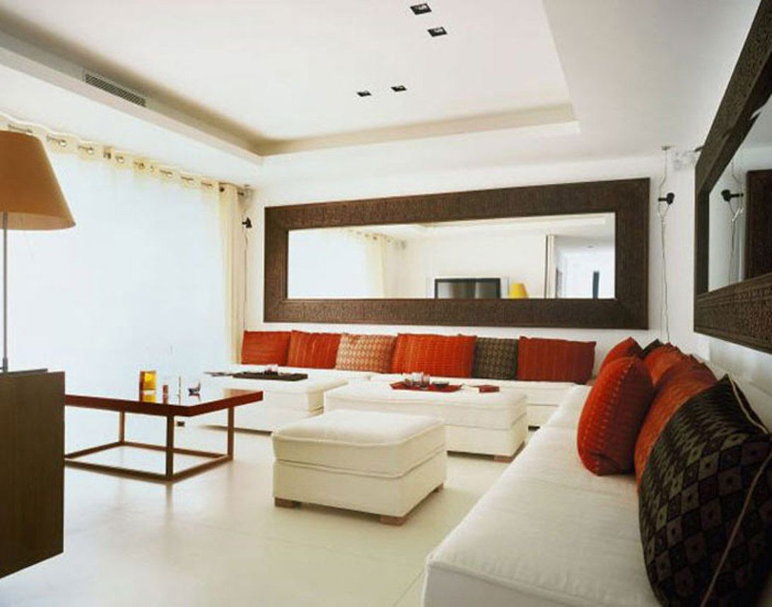 Decorating large living room with wall mirror decorative mirrors very large wall mirrors decorating long and very large wall mirrors with luminous rom and long white couch with many cushions and simple t amipublicfo Images