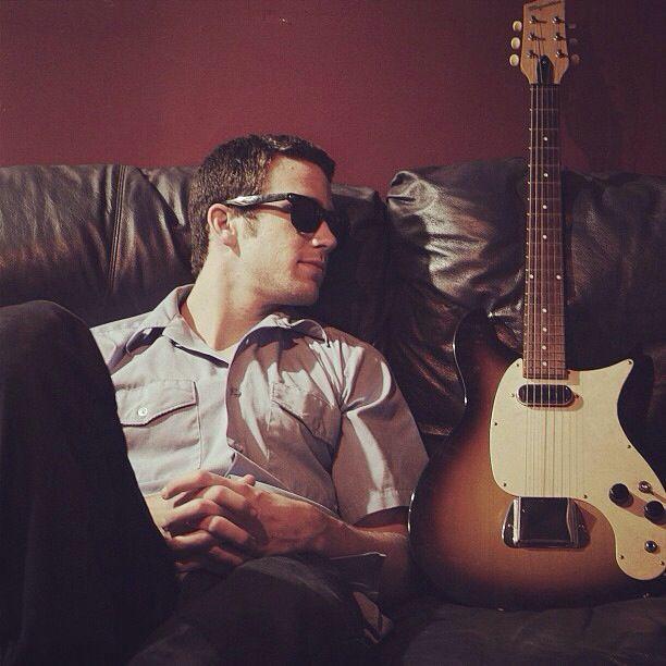 Men who play guitar. Trevor Holmes