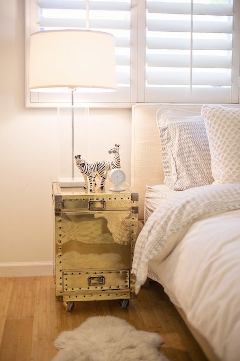 Minimalist Bedroom With Ivory Linen Headboard Bed And Vintage Brass Trunk  Nightstand