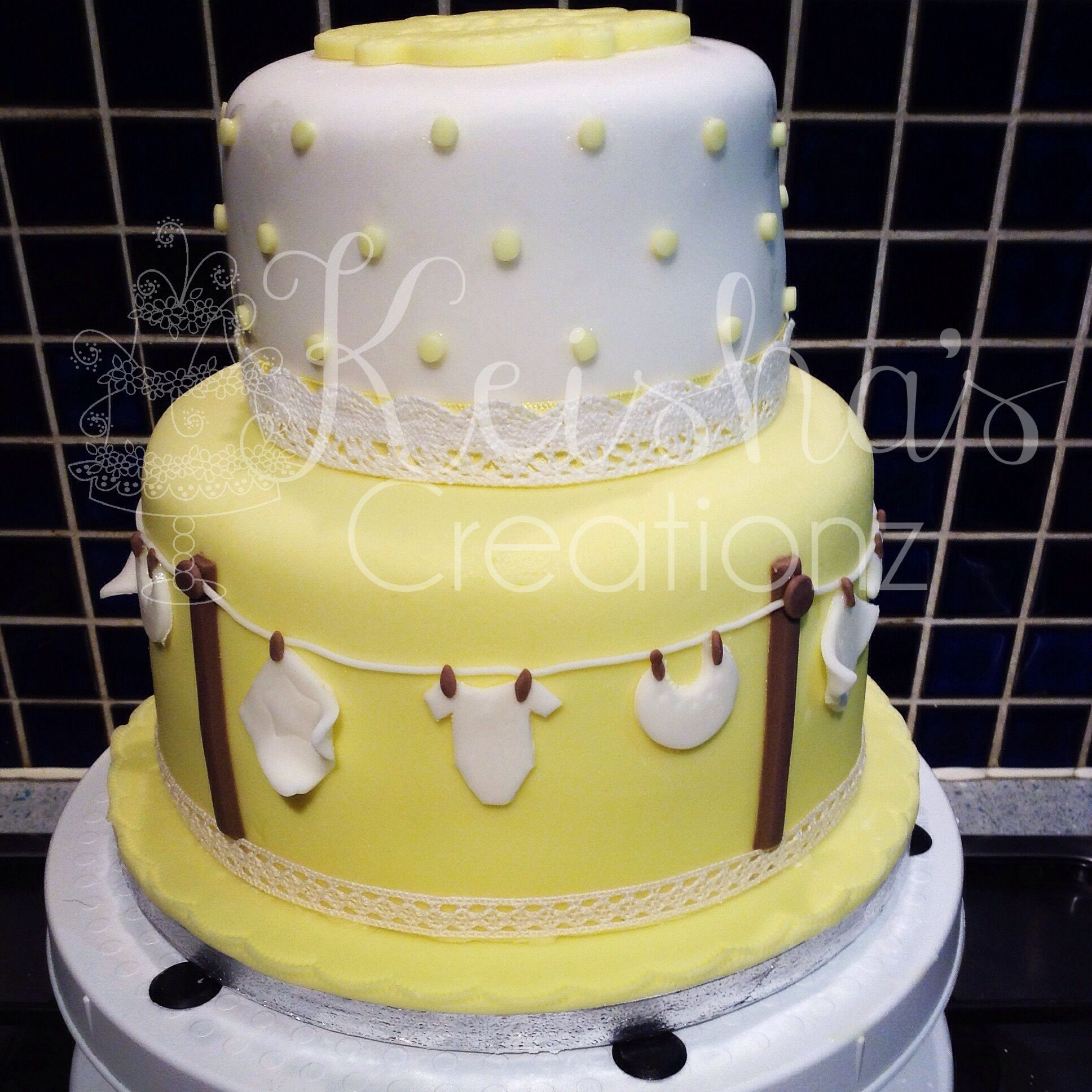 2 Tier Gender Neutral Baby Shower Cake By Keisha S Creationz Featuring Miniature Washing Line And Baby Clothes Baby Shower Cakes Cupcake Cakes Cake