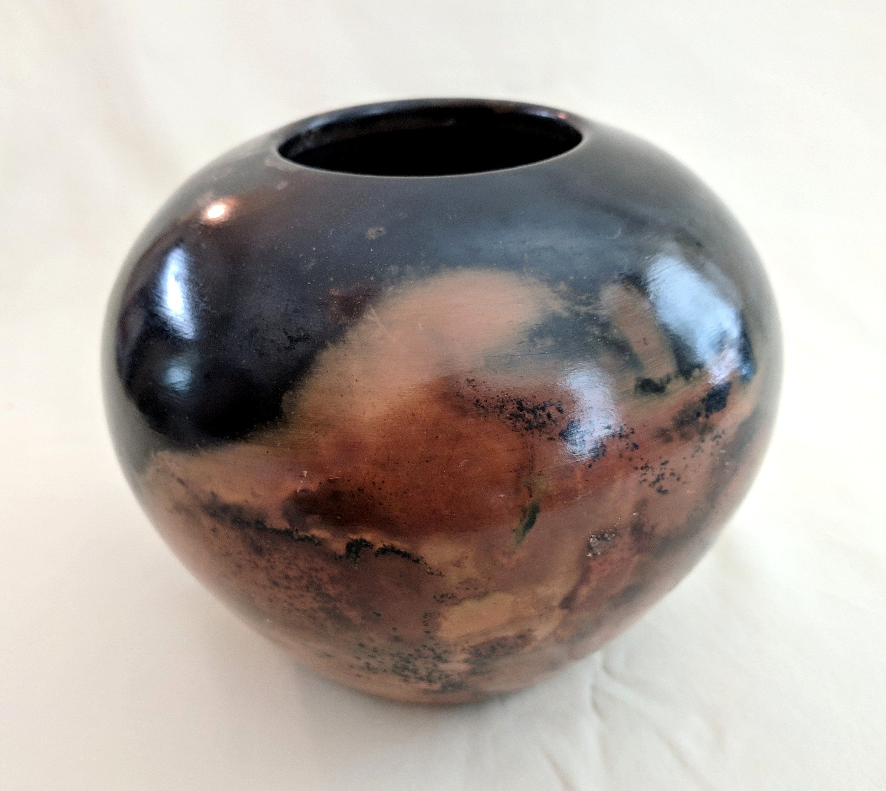 Black and orange abstract art pottery signed 1990