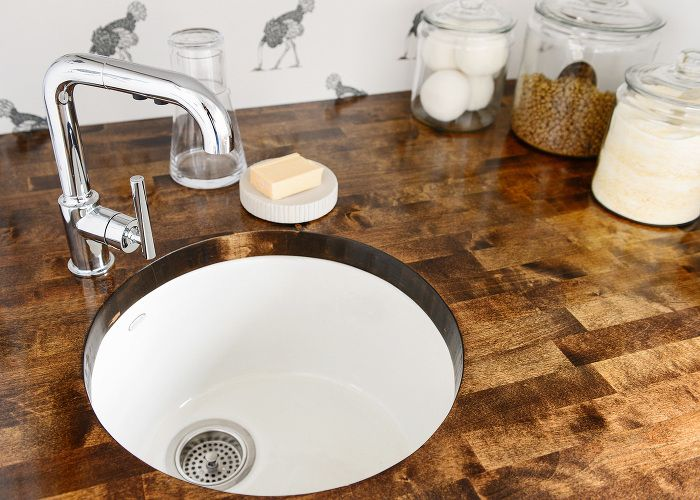Well Appointed Laundry Features A Round Undermount Sink Paired With A  Polished Nickel Faucet Kit Mounted