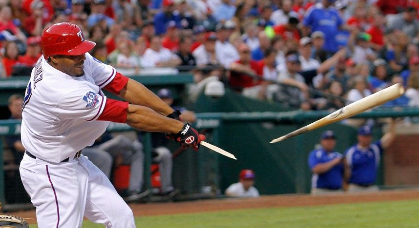 Texas Rangers right fielder Nelson Cruz breaks his bat after hitting a pitch from Tampa Bay Rays pitcher David Price in the second inning of their MLB American League baseball game in Arlington, Texas