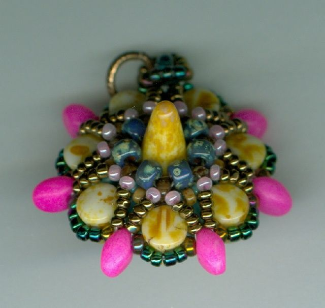 Spike Pendant made with hybrids, pellit beads, superduo's, superuno's and 24K Gold Iris seed beads. by Marcie Lynne