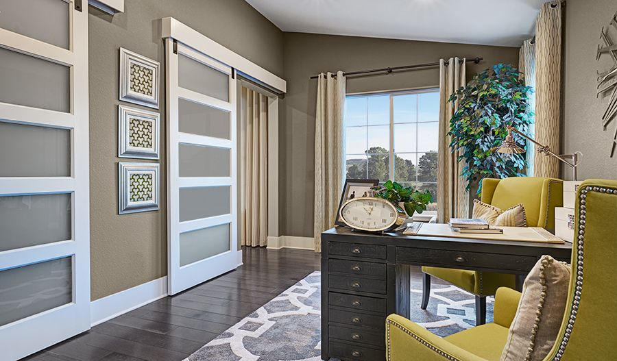 Barn doors add character to this chic study in Aurora, CO ...