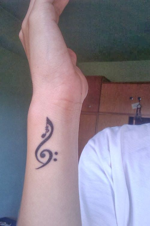 Music note tattoos on hand