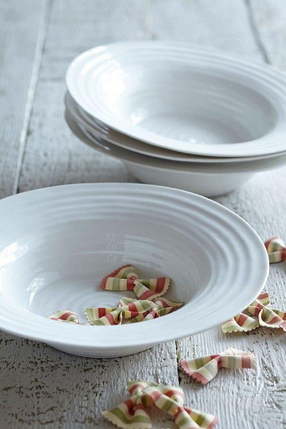 four white lipped pasta bowls