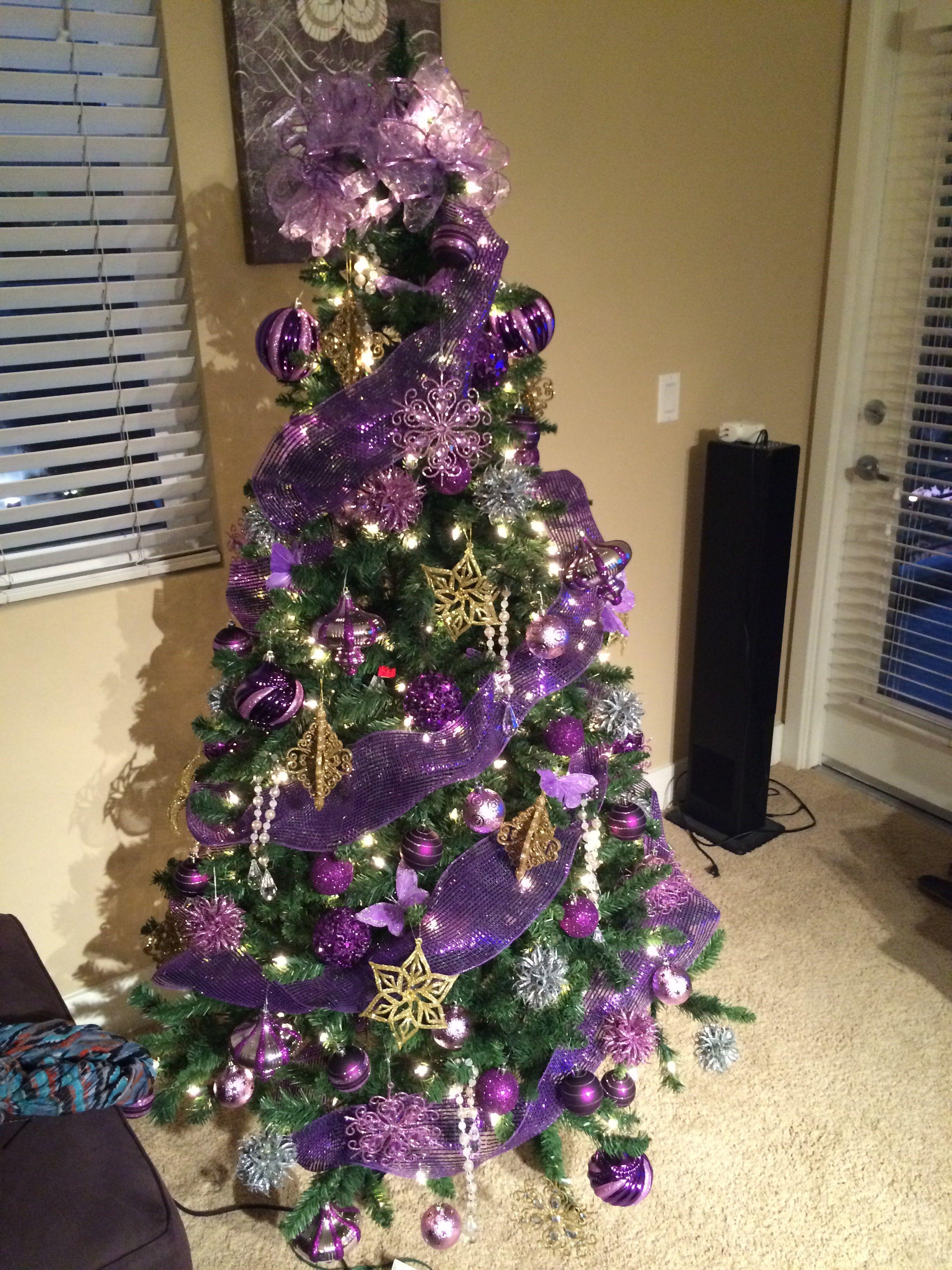 Purple Gold And Silver This Year We Dedicate Our Christmas Tree To The Ki Purple Christmas Tree Purple Christmas Decorations Christmas Tree Decorations Diy