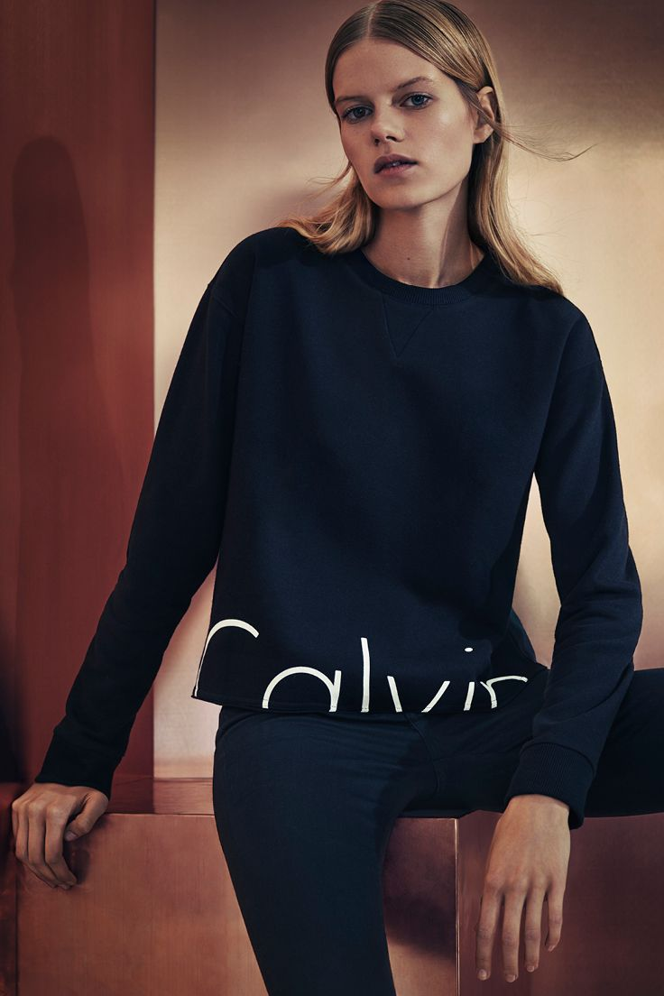 8414e05a6fcf0 Spend the holidays in  mycalvins with the iconic logo cropped sweatshirt  from Calvin Klein Jeans.