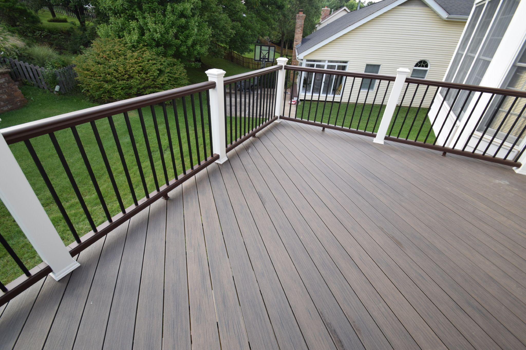 A Deckorators Deck In Ironwood Color Beautiful Rich Wood Grains Brown And White Railing Dream Decks Become Real At Calif Synthetic Decking Custom Decks Deck