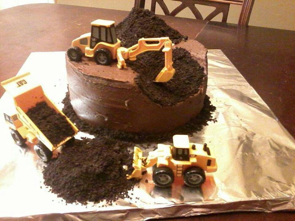 Dirt & lil boy toys = cake under construction